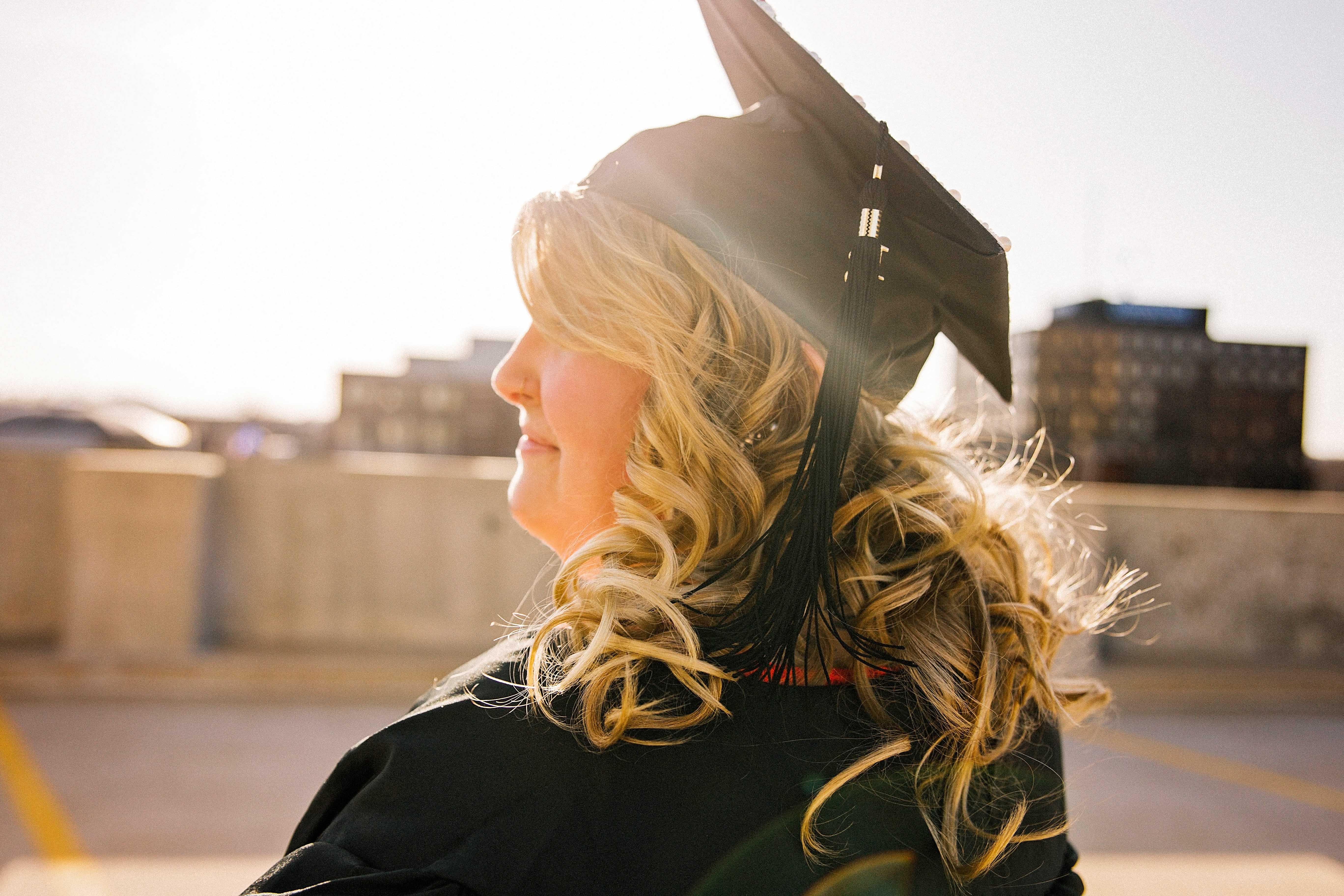 women graduating university, smiling