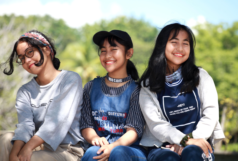 young women volunteers, smiling