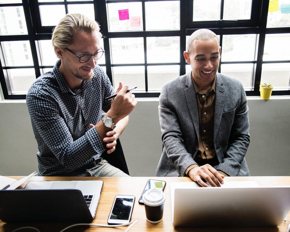 men smiling, brainstorm meeting